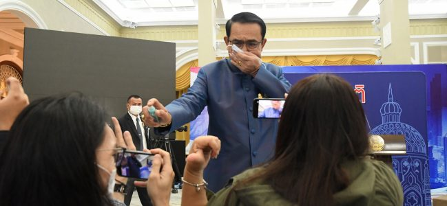 Thailand's Prime Minister Sanitizes Front Row of Reporters at Press Conference